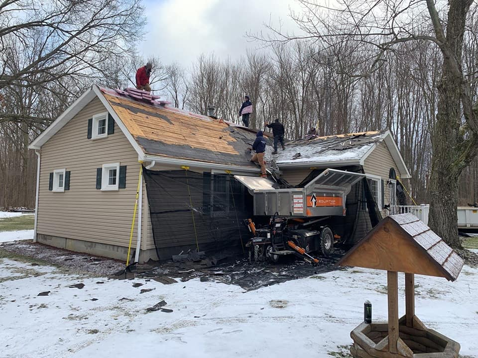 Working to install a roof in the middle of winter?