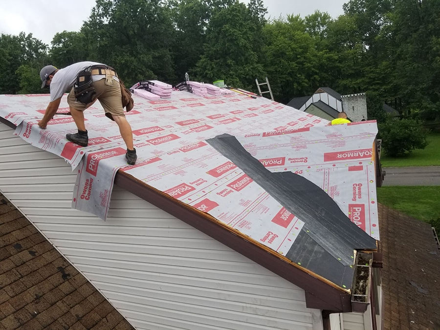 Installing a brand new roof on a home.