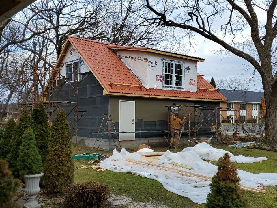 The Schmucker's team installing a roof on new construction.