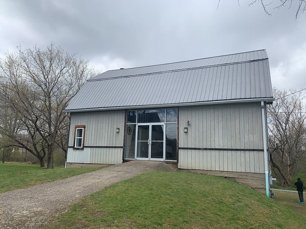 A metal roof installed on a public service building.