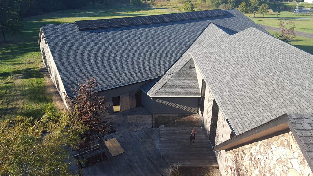 Aerial view of a roof. Do you see the onlooker?