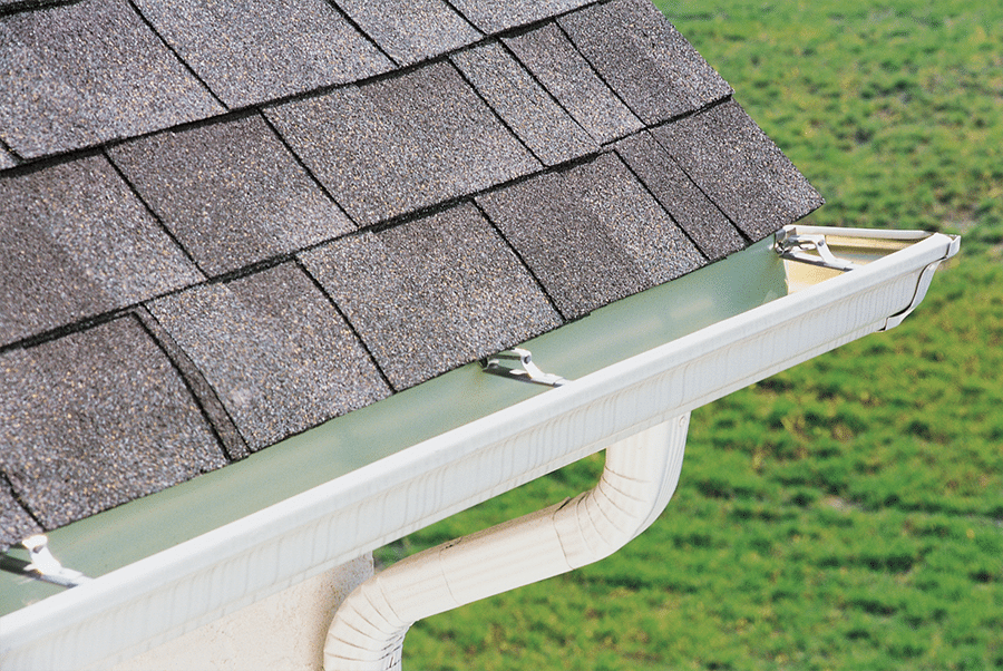 Repairing a gutter system and old shingles.