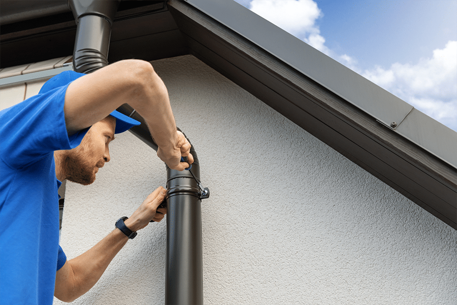 Putting the finishing touches on a brand new gutter system.